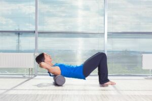 10 Strengthening Moves To Do With A Exercise Foam Roller